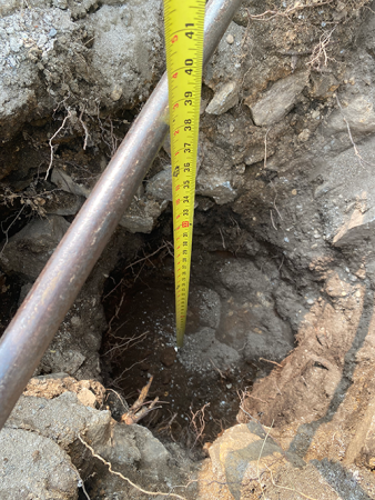 digging wholes and measuring for depth